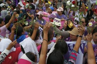 Hundreds of activists in pink and purple shirts protested in downtown Manila against Philippine President Rodrigo Duterte, calling him among the worst violators of women's rights in Asia. Photo: AP
