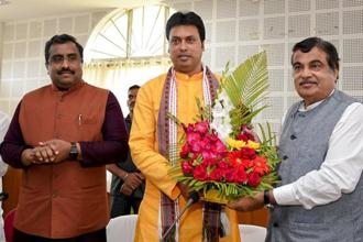 Biplab Deb (centre) with Union minister Nitin Gadkari and BJP leader Ram Madhav (left) in Agartala on Tuesday. Photo: AP