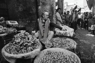 Alain Passard sifts through piles of potato, ginger and garlic—an extension of his abiding love for all manner of vegetables. Photo: Rohit Chawla