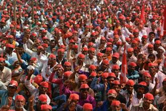 Farmers shout slogans at a protest rally in Mumbai on Monday. Photo: AFP