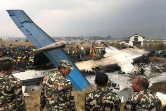 Nepalis and Bangladeshis made up the death toll in the Kathmandu plane crash. Photo: Reuters