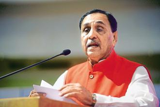 Gujarat Chief Minister Vijay Rupani. The trouble began when senior Congress legislator from Jamnagar Vikram Madam tried to raise a point of order concerning the deaths of two children in the Asaram Ashram in 2008.