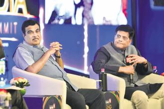 Transport minister Nitin Gadkari (left) and railway minister Piyush Goyal at the News 18 Rising India Summit in New Delhi on Friday. Photo: Pradeep Gaur/Mint