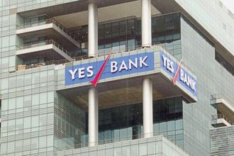 At 12.23pm, Yes Bank shares traded 0.62% up at Rs314.35 on BSE, while Fortis Healthcare shares declined 1.25% to Rs158.20. Photo: Mint