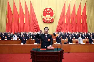 Chinese President Xi Jinping takes an oath of allegiance to the constitution after being formally re-elected as president during a plenary session of China's National People's Congress (NPC) at the Great Hall of the People in Beijing on Saturday. Photo: AP