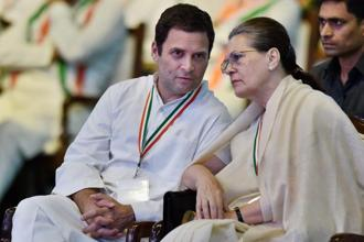 Congress president Rahul Gandhi with party chairperson Sonia Gandhi during the 84th Plenary Session of Indian National Congress (INC) at the Indira Gandhi Stadium in New Delhi on Saturday. Photo: PTI