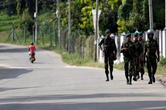 A file photo shows Sri Lanka special task force soldiers patrolling along a road after a clash between two communities in Digana, central district of Kandy, on 8 March. Photo: Reuters