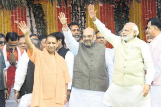 A file photo of Yogi Adityanath (left) with BJP chief Amit Shah (centre) and Prime Minister Narendra Modi. The Yogi government completes a year in office on Monday. Photo: HT