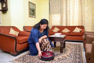 Shivani Das using her Milagrow robotic cleaner. Photo: Ramesh Pathania/Mint