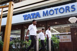 Tata Motors said it will hike prices of its passenger vehicles by up to Rs60,000 from 1 April, and similarly, Nissan said it will increase prices of its vehicles by up to 2% in India from next month. Photo: Bloomberg