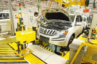 Mahindra also plans to increase, by more than half, the number of local servicemen called Mahindra Mitratechnicians. Photo: Mint