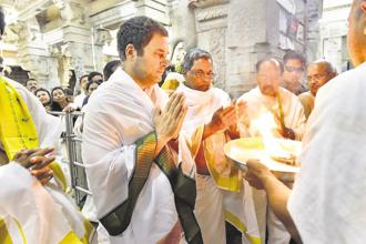 Congress chief Rahul Gandhi with Karnataka CM Siddaramaiah at Sharadamba temple in Chikmagalur on Wednesday. Photo: PTI