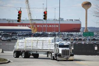 A loaded truck leaves the Dundalk Marine Terminal on 9 March, 2018 in Baltimore, US. Both the US and Chinese economies are strong enough to take the hit from a trade war and keep on growing soundly—unless the clash spirals out of control, say economists. Photo: AFP