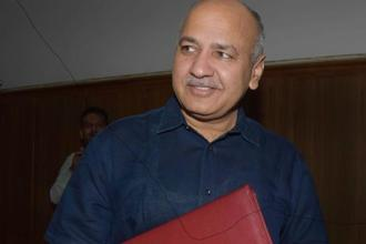 Delhi deputy chief minister Manish Sisodia arrives to present the Delhi government budget for 2018-19 in the assembly on Thursday. Photo: PTI