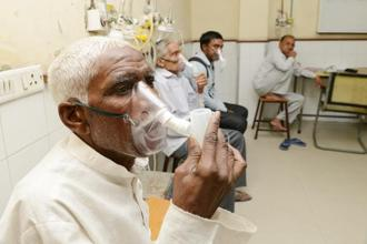 A file photo of tuberculosis (TB) patients taking a nebulizer at a hospital in Delhi. Photo: Ramesh Pathania/Mint