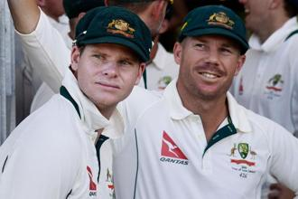 Steve Smith (left) resigned as Australia captain on Sunday and was suspended for one Test by the ICC. David Warner (right) also resigned as vice captain. Photo: AFP