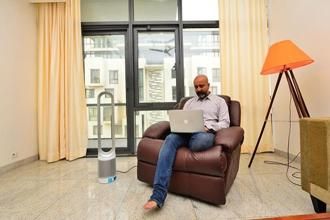 Asif Mohamed with his Dyson air purifier. Photo: Priyanka Parashar/Mint