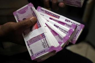 The rupee closed at 64.97 a dollar, down 0.16% from its previous close of 64.87. Photo: Reuters