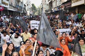 A file photo of family members of Delhi traders protesting the ongoing sealing drive at Lajpat Nagar in New Delhi. Photo: PTI