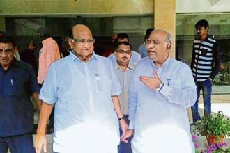 NCP chief Sharad Pawar (left) and Congress leader Mallikarjun Kharge after a meeting with farmers' organizations in Delhi on Wednesday.
