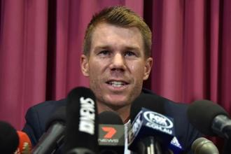 Australian cricketer David Warner crying at a press conference at the Sydney Cricket Ground on Saturday. Photo: AFP