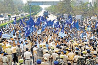 Protesters march in Chandigarh on Monday. Blue flags stand out as the most visible marker of Dalit protests in recent years. Photo: Reuters