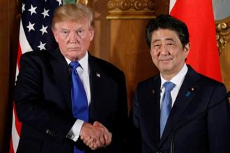 File photo. US President Donald Trump and Japan's prime minister Shinzo Abe shake hands at the end of a news conference in Tokyo. Photo: Reuters