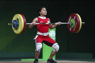 Sanjita Chanu lifts to win Gold medal in women's 53Kg weightlifting final during the Commonwealth Games, in Gold Coast on 6 April 6 2018.  Photo: AP