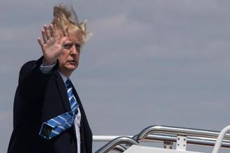 US President Donald Trump boards Air Force One on a windy day at Andrews Air Force base on 5 April, 2018 near Washington. Photo: AFP