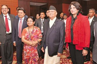Nepal Prime Minister K.P. Sharma Oli (centre) with Indian business leaders ahead of a meeting in New Delhi on Friday. Photo: PTI