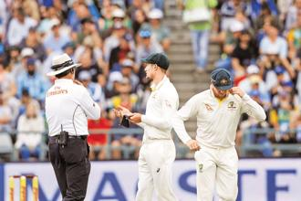 Cameron Bancroft (left) and Steve Smith being questioned by the umpire. Photo: AP