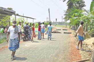 Protesters have alleged that land was being grabbed by agents of Trinamool Congress leaders for a project that could potentially harm agriculture. Photo: Indranil Bhoumik/Mint