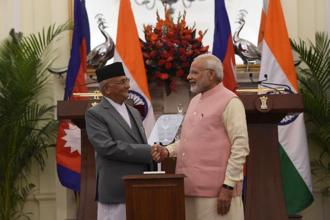 Prime Minister Narendra Modi (R) and Prime Minister of Nepal K.P. Sharma Oli shake hands after the inauguration of India-Nepal petroleum products pipeline and the Integrated Check Post (ICP), at Hyderabad House, in New Delhi on Saturday. Photo: AFP