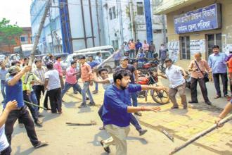 Activists of two political parties clash in Burdwan on Saturday ahead of West Bengal panchayat elections. Photo: PTI