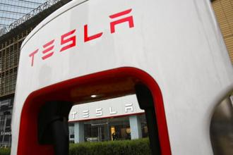 Tesla has declined to say how long drivers can now use Autopilot between visual or audible warnings to have a hand on the wheel. Photo: AP