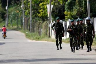 A file photo shows Sri Lanka special task force soldiers patrolling along a road after a clash between two communities in Digana on 8 March. Photo: Reuters