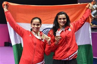 The women's badminton singles gold medalist Saina Nehwal (left) and silver medalist P.V. Sindhu at the Commonwealth Games 2018, in Gold Coast, Australia on Sunday. Photo: PTI