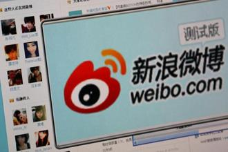 The logo of Sina Corp's Chinese microblog website 'Weibo' is seen on a screen in this photo illustration taken in Beijing. Photo: Reuters
