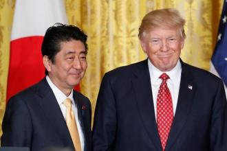 Shinzo Abe will likely seek to get  Donald Trump to reverse his decision not to exclude Japan from new steel and aluminium tariffs, while resisting the US leader's attempts to pull Japan into bilateral trade negotiations. Photo: AP