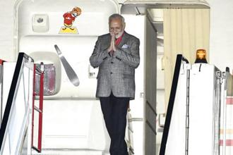 Prime Minister Narendra Modi emerges from his plane as he is welcomed on arrival at Arlanda Airport in Stockholm, Sweden. Photo: AP
