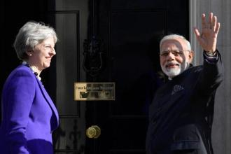 Britain's Prime Minster Theresa May welcomes Indian Prime Minister Narendra Modi, who is visiting the UK to attend the CHOGM conference, to 10 Downing Street in London, 18 April 18, 2018. Photo: Reuters