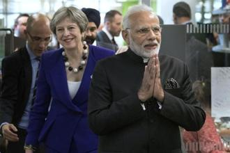 Indian Prime Minister Narendra Modi and his British counterpart Theresa May during a visit to the Francis Crick Institute in London on 18 April, 2018.