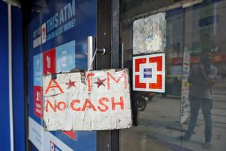 The growth in ATM cash withdrawals is much higher compared to that in FY16 or FY15 and even the five-year average of 8.2% during FY12 to FY16, the SBI report said. Photo: Reuters