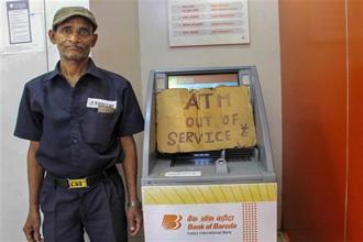 The current cash crunch does seem to be temporary and should be resolved once the demand-supply mismatch is addressed. What may persist is the ATM recalibration issue and it is important to examine it. Photo: PTI