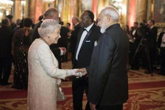 Britain's Queen Elizabeth II, greets Prime Minister Narendra Modi in the Blue Drawing Room at Buckingham Palace as the Queen hosts a dinner during the Commonwealth Heads of Government Meeting, in London, on Thursday. Photo: AP