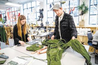 Christopher Raeburn, turning a MiG jet fighter jumpsuit into hand bags. Photo: AFP