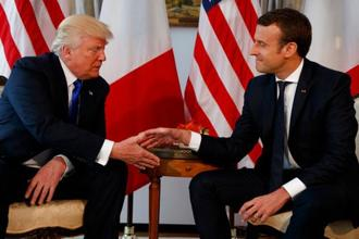 A file photo of US President Donald Trump shaking hands with French President Emmanuel Macron. The two men have an unlikely friendship, despite strong differences on areas such as climate change. Photo: AP