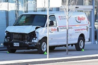 A damaged van seized by police is seen after multiple people were struck at a major intersection in northern Toronto, in Cananda. Photo: Reuters