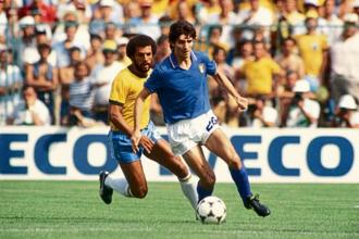 Paolo Rossi of Italy shielding the ball from Brazil's Junior during a World Cup match at the Estadi de Sarrià on 5 July 1982. Photo: Getty Images