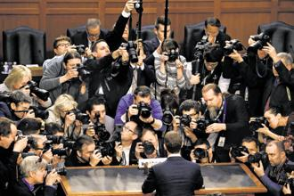Facebook CEO Mark Zuckerberg is surrounded by members of the media as he arrives to testify in Washington, on 10 April. Photo: Reuters